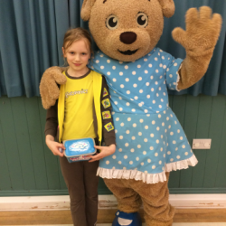 Girl Guide makes birthday donation to Claire House
